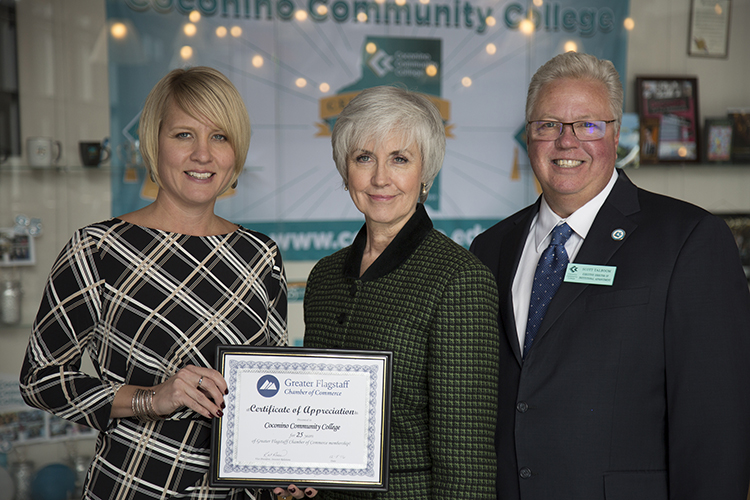 President Colleen A. Smith and Executive Director of Institutional Advancement Scott Talboom accept a certificate of appreciation for 25 years of serving the community as a Chamber member from the Chamber's Vice President of Investor Relations Kat Ross